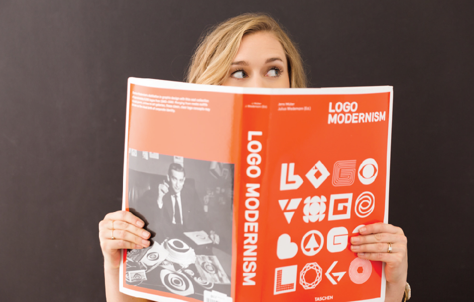 Image of Creative Director Jordis Small reading Logo Modernism for What is Logo Design